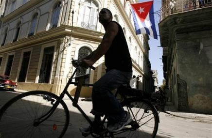 2484241711-man-rides-his-bike-along-street-in-old-havana-wednesday